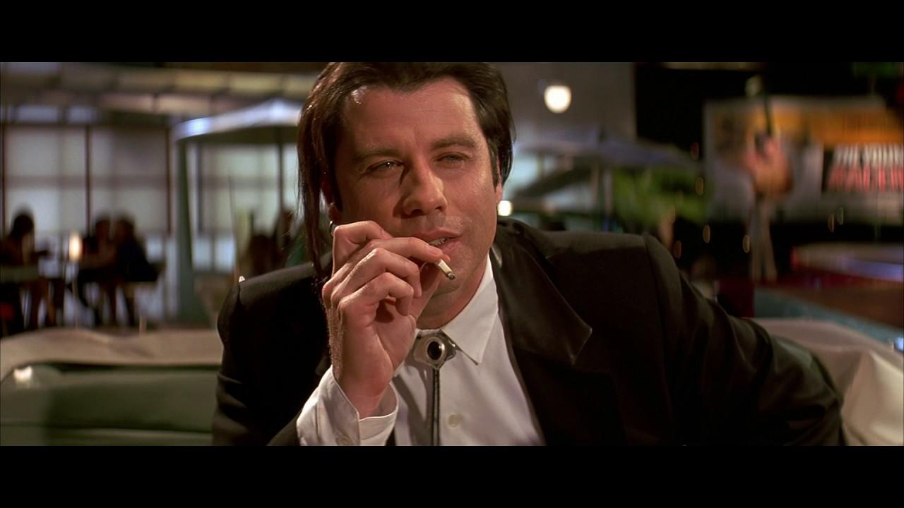 """Il look di Vincent Vega in Pulp Fiction è opera di Travolta: """"Scelsi io il capello lungo e l'orecchino"""""""